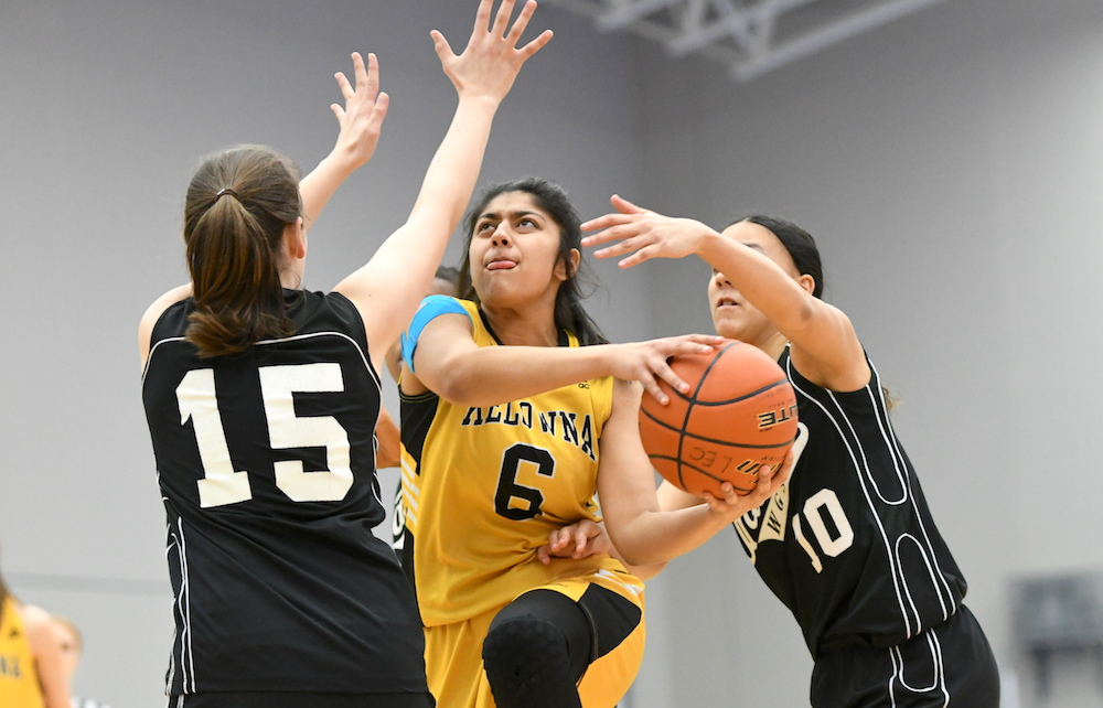 Kelowna Junior Japleen Chahal Centre Finds The Going Tough Against Walnut Groves Anneke Cairnie Left And Juliana Jacobs During Elite 8 BC