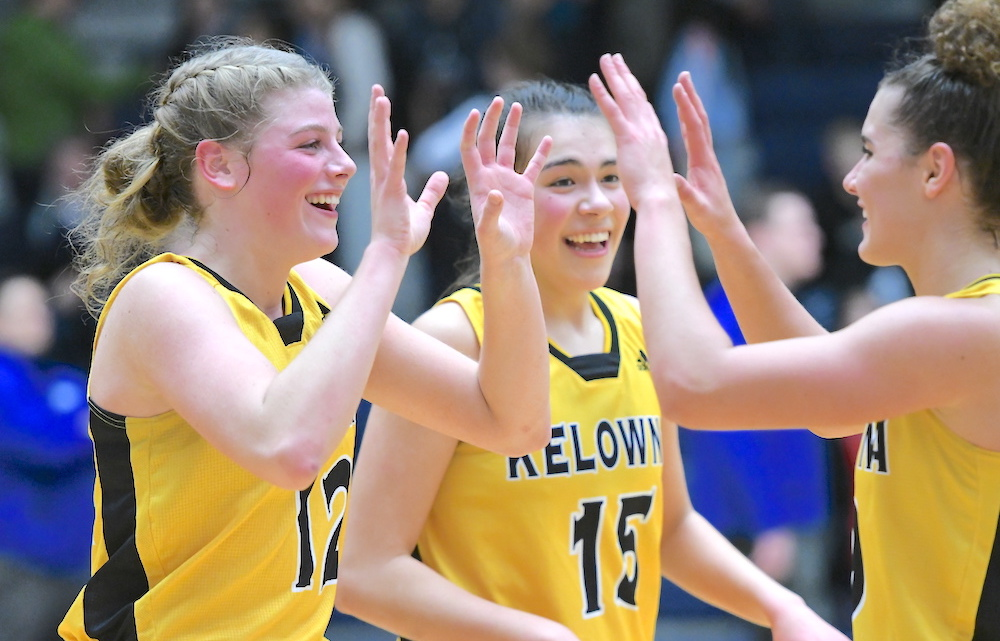 Kelownas Jaeli Ibbetson Centre Casts A Smile Has Her Teammates Kennedy Dickie Left And Taya Hanson Celebrate Final Four Win Over Semiahmoo On LEC